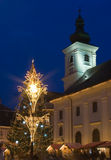 Chrismas tree town square center sibiu church. Catholic transylvania romania  light decoration lantern lamp Royalty Free Stock Photos
