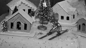 Christmas Tree Village with ski figurine old fashioned black and white Royalty Free Stock Photography