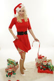 Chrismas woman show the leg Royalty Free Stock Images