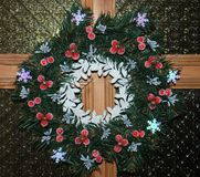 Chrismas wreath on the wood door. With glass at home Royalty Free Stock Images