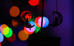 Chrismass decorations two black silhouettes of fairies on the moon Stock Photo
