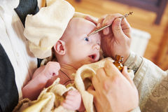 Chrismation sacrament of newborn baby during christening Royalty Free Stock Images