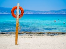 Chrissi Island, Crete, Greece. A lifebuoy on the Golden Beach, symbol of assistance, security, rescue, SOS. Golden Beach in Chrysi island, one of the wildness royalty free stock photos