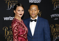 Chrissy Teigen and John Legend. At the Los Angeles premiere of `Beauty And The Beast` held at the El Capitan Theatre in Hollywood, USA on March 2, 2017 Stock Image