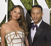 Chrissy Teigen and John Legend. Supermodel Chrissy Teigen and her singer and producer husband, John Legend, arriveson the red carpet at the 71st Annual Tony royalty free stock images