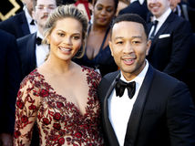Chrissy Teigen and John Legend. At the 88th Annual Academy Awards held at the Hollywood & Highland Center in Hollywood, USA on February 28, 2016 Royalty Free Stock Photo