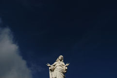 Christ against blue sky Stock Photography