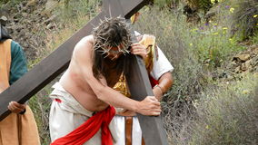 Christ carrying the cross road to Calvary 2 stock footage