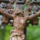 Christ on the cast- iron cross in the old cemetery Stock Image