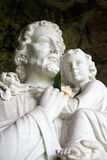 Christ with Child. Marble statue of Jesus Christ holding small child royalty free stock photography