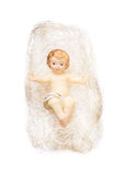Christ child figurine in angel hair on white background Royalty Free Stock Images