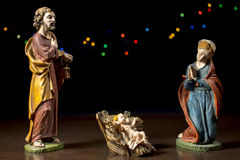 Christ child between Mary and Joseph. Christmas traditions. Stock Photos