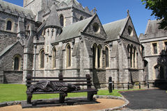 Christ Church Cathedral, Dublin. Christ Church Cathedral is the cathedral of the United Dioceses of Dublin and Glendalough. On the bench there is a sculpture Stock Photos