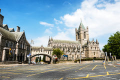 Christ Church Cathedral during the sunny day in Dublin, Ireland. Dublin, Ireland. Car traffic with the Christ Church Cathedral during the sunny day in Dublin Royalty Free Stock Photo