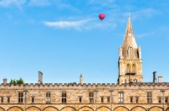 Christ Church with hot ballon flying passed over in Oxford University Stock Images