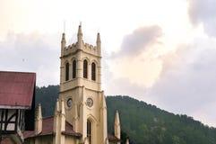 Christ church shimla shot against a cloudy sky. Christ church in shimla, a famous landmark shot against a beautiful sunset cloudy sky with golden light Stock Photography