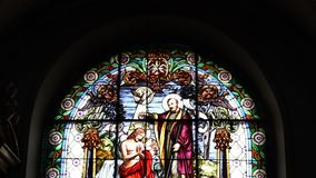 Christ Church Stained Glass. Beautiful stained glass depicting Jesus Christ baptism, from an old christian church, tilt shot stock video footage