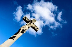 Christ on the cross. This is an image of Jesus Christ after having been crucified on the cross set with a blue sky background. This is a monument is located in a royalty free stock image