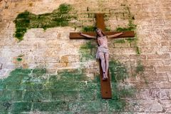 Christ on damaged wall Stock Photography