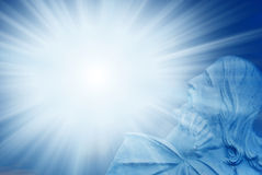Christ with divine Light. Jesus Christ praying over rays of divine Light royalty free stock photography