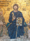 Christ enthroned, flanked by  Constantine IX Monomachus. Christ enthroned,  Byzantine mosaic in the gallery of  Hagia Sophia  in Istanbul, Turkey Royalty Free Stock Images