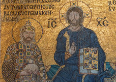 Christ enthroned, flanked by  Constantine IX Monomachus. Husband of Empress Zoe,  Byzantine mosaic in the gallery of  Hagia Sophia  in Istanbul, Turkey Royalty Free Stock Image
