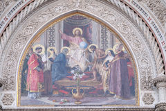 Christ enthroned with Mary and John the Baptist. Christ Enthroned with Mary and St. John the Baptist Main Portal of Cattedrale di Santa Maria del Fiore Cathedral Stock Photos