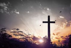 Christ Jesus concept: cross in the morning at sunrise royalty free stock images