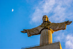 Christ the King monument in Lisbon, Portugal. Sunset at Christ the King monument placed in the city of Almada, district of Lisbon, the capital of Portugal Royalty Free Stock Images