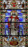 Christ the King. Stained glass church window stock photos