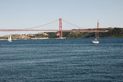 The Christ the King statue and 25 April bridge over the Tagus river in Lisbon, Portugal Royalty Free Stock Images