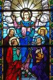 christ lärjungeexponeringsglas hans nedfläckada fönster Arkivbild