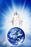 Christ love for Earth. Jesus Christ with blessing and loving gesture above Earth over sky with divine rays of light