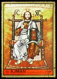 Christ Pantocrator, Byzantine mosaics of Saint Mark`s Basilica in Venice serie, circa 1972. MOSCOW, RUSSIA - MAY 25, 2019: Postage stamp printed in Ajman shows royalty free stock images