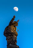 Christ points at the moon Stock Photography