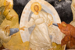 Christ is pulling Adam and Eve from the underworld, an old fresco stock photo
