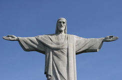Christ the redeemer. (Portuguese: O Cristo Redentor), is a statue of Jesus Christ in Rio de Janeiro, Brazil. The statue is located at the peak of the Corcovado Royalty Free Stock Images