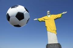 Christ the Redeemer Brazilian Football Brazil Colors Soccer Uniform. Christ the Redeemer wearing Brazil colors soccer uniform with football at Corcovado Rio de Stock Image