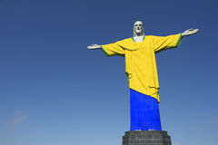 Christ the Redeemer Brazilian Football Soccer Colors Uniform. Christ the Redeemer wearing Brazil colors football soccer uniform at Corcovado Rio de Janeiro Royalty Free Stock Photos