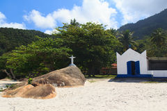 Christ the Redeemer and Church on beach Aventueiro, Ilha Grande, Brazil Stock Photo