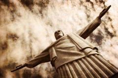 Christ Redeemer at the Corcovado Hill. Rio de Janeiro, Brazil - June 12 2014: Dramatic shot of the Christ Redeemer at the Corcovado Hill, one of the most iconic Royalty Free Stock Photos