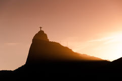 Christ the Redeemer statue on Corcovado mountain by sunset Stock Images