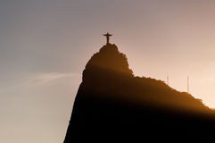 Christ the Redeemer statue on Corcovado mountain by sunset Stock Image