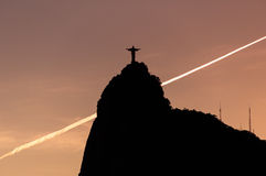 Christ the Redeemer statue on Corcovado mountain by sunset Royalty Free Stock Image