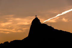 Christ the Redeemer statue on Corcovado mountain by sunset Stock Photography