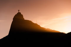 Christ the Redeemer statue on Corcovado mountain by sunset Royalty Free Stock Photo