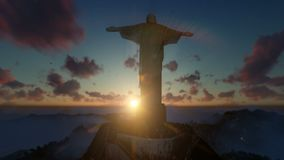 Christ the Redeemer with tourists above clouds at sunset, Rio de Janeiro, panning royalty free illustration