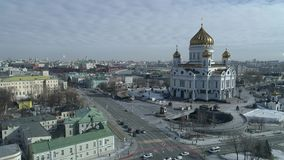 Russia, Moscow, Christ the Savior Cathedral, Kremlin shooting from the air, day, winter 4K. stock video footage