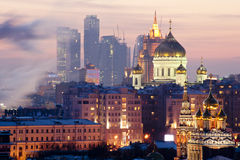Christ the Savior Cathedral. View of the Christ the Savior Cathedral and business center in the evening Stock Photography