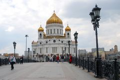Christ the Savior Church in Moscow, Russia. MOSCOW - APRIL 24: Christ the Savior Church and Patriarchal bridge in Moscow, Russia on April 24, 2012 in Moscow Stock Photo